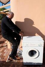 Mr. Pretorius pedaling his way to clean washing