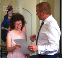 Emily Davis, 16, receiving her Bronze Award from Tim Walker