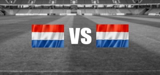 Zwei Holland Flaggen und ein vs Schriftzug dazwischen