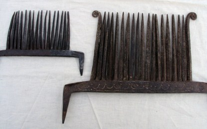 Two early hand-forged ripples, used for removing the seed balls from the pulled and dried flax plants.
