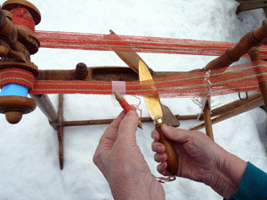 Beater knife in use on Swedish band loom.