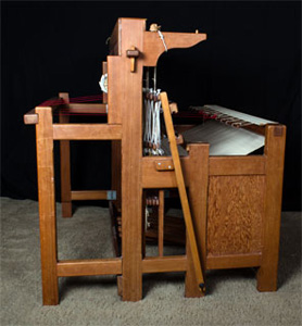 Side view of a Bergman loom showing back and front open.
