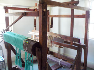 Early 19th-century barn-frame four-post loom at John Greenleaf Whittier Homestead in Haverhill, MA.