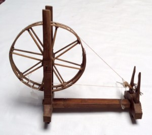 Child-size spinning wheel from Thailand.