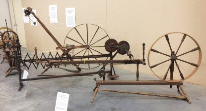 Kim's display. Three moving-spindle wheels from Falls Mill Museum.