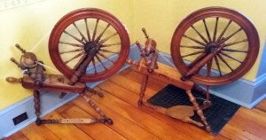 Two spinning wheels marked O. DION.