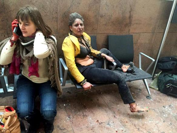 In this photo provided by Georgian Public Broadcaster and photographed by Ketevan Kardava two women wounded in Brussels Airport in Brussels, Belgium, after explosions were heard Tuesday, March 22, 2016. A developing situation left at least one person and possibly more dead in explosions that ripped through the departure hall at Brussels airport Tuesday, police said. All flights were canceled, arriving planes were being diverted and Belgium's terror alert level was raised to maximum, officials said. (Ketevan Kardava/ Georgian Public Broadcaster via AP)