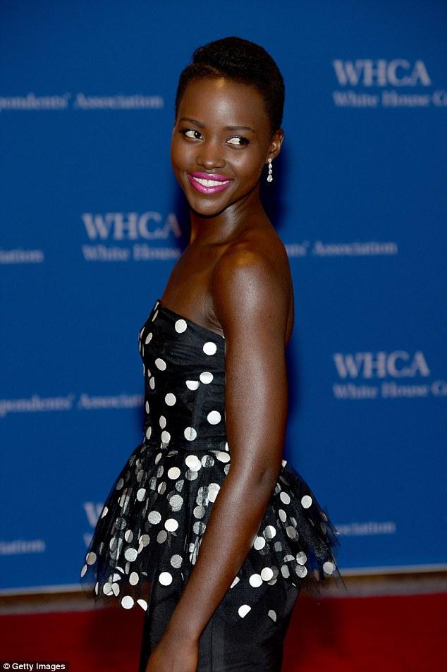 Glamorous: Lupita Nyong'o won an Oscar for 12 Years a Slave and cut a stunning figure among the dignitaries