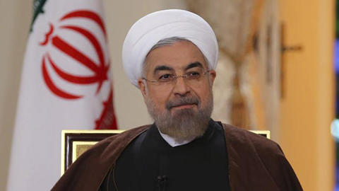 Iranian President Hassan Rouhani, shown on state-run TV in Tehran on Oct. 13, has reportedly directed Iran's oil ministry to seek a meeting of the Organization of Petroleum Exporting Countries cartel next month to discuss propping up oil prices. (Mohammad Berno / Associated Press)