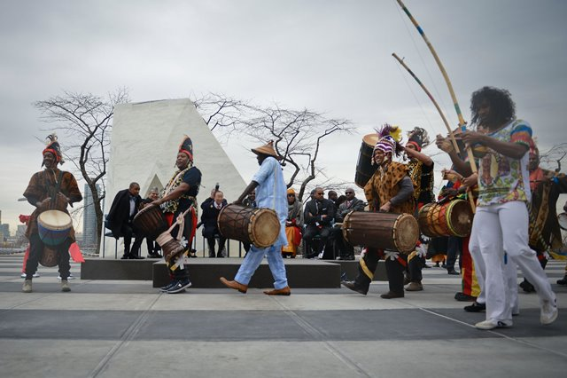 "Artists perform at the end of the unveiling ceremony of a permanent memorial named ""Ark of Return"" to honour the victims of slavery and the transatlantic slave trade, at the UN headquarters in New York, on March 25, 2015. The UN unveiled a permanent memorial at the UN Headquarters in New York on Wednesday to honor the victims of slavery and the transatlantic slave trade. (Xinhua/Niu Xiaolei)"