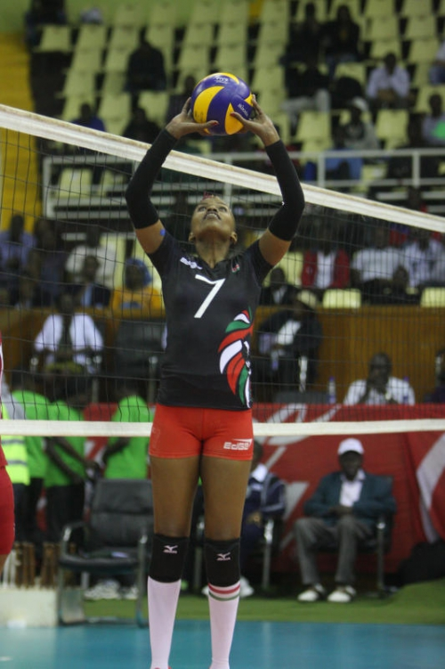 Kenya's Janet Wanja sets up an attack against mauritius during their Africa Cup of Nation at Kasarani Gymnesium on June 12, 2015.PHOTO/DENNIS OKEYO