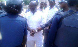 Maxwell Kofi Jumah in handcuffs after his arrest on Saturday