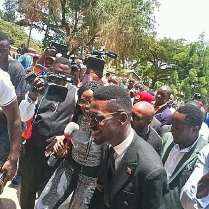 Bobi Wine and other celebrities talking to the press after mass
