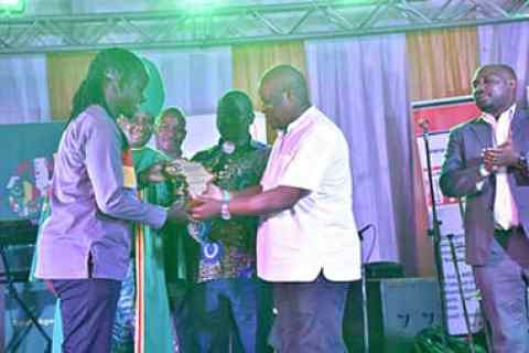 Safe Boda CEO Ricky Rapa (L) receives his award