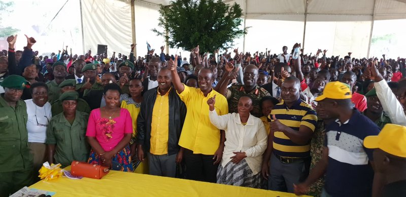 Capt. Mike Mukula (C) poses with Min. Frank Tumwebaze and other National Resistance Movement supporters