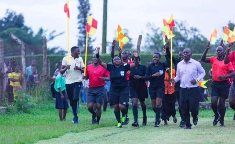 Aisha Nabikko Ssemambo jogging with other referees