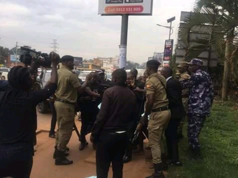 Uganda Police officers brutalising journalists