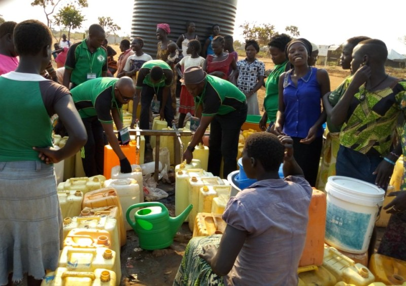 PAP Team helping Refugees to fetch Water