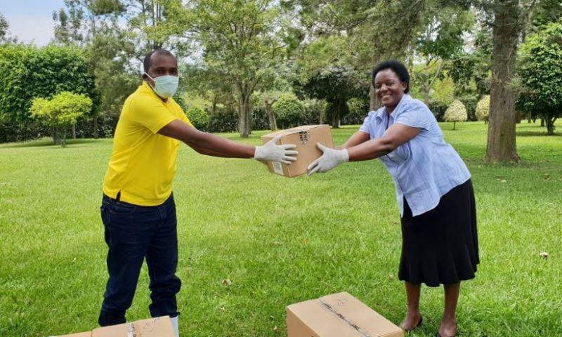 Min. Tumwebaze Boosts Fight Against Coronavirus By Donating Liquid Soap, Safety Gear To Kamwenge People