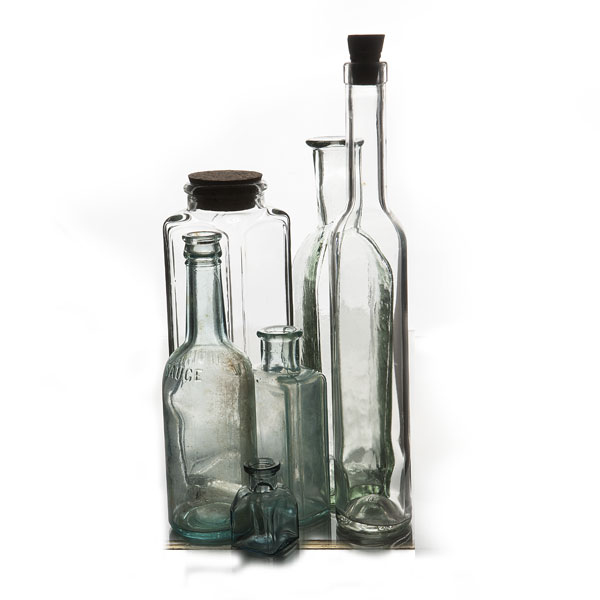 Assorted vintage bottles