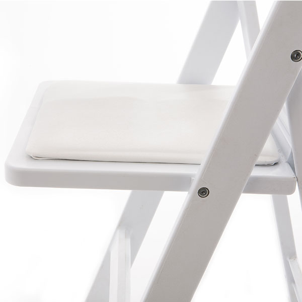 Close up view of white resin padded folding chair