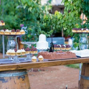 Wine barrel bar used to display cakes and cupcakes