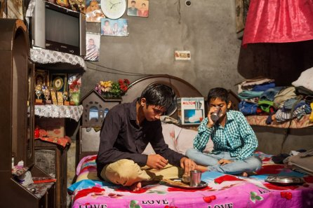 Rohit, 15, and Sajan, 14, have their breaksfast before leaving for school in the morning at their house in the Nangalkotli neighbourhood of Gurdaspur, Punjab, India. August 05, 2016.