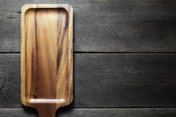 wood cutting board on wood background