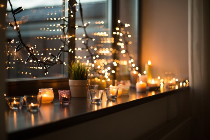 candles and string lights in a window