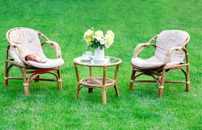 outdoor seating area with table and floral