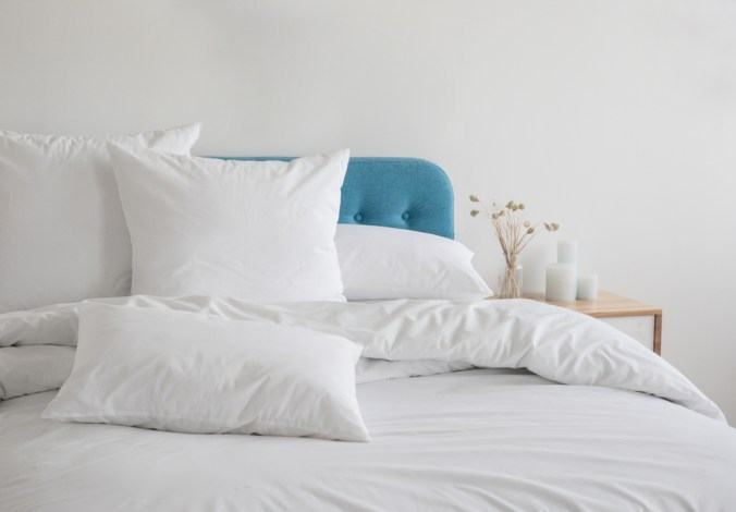 bed with white fluffy pillows and bedding