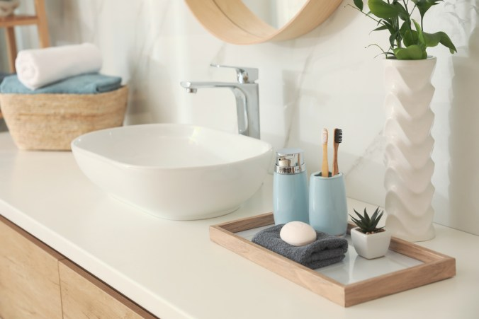 bath vanity stocked with toiletries