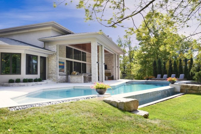 Custom home outdoor living space design with pool in St Louis MO