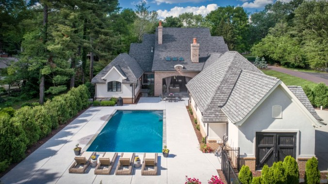Custom home design rear courtyard and pool terrace