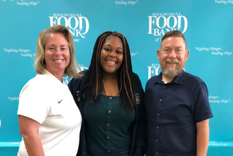 Assistant Athletic Director and Student Government Association Sponsor Leslie Sewell, Student Government Association President Tijah Johnson and Vice President for Student Affairs Dr. Bill Knowles attend a training event at the Regional Food Bank of Oklahoma to help kick start the College's food bank initiative.