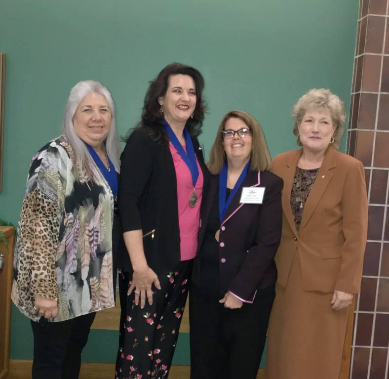 SSC President Lana Reynolds (right) stands by SSC's 2019 Outstanding Employees at the Oklahoma Community Colleges Association annual conference Oct. 4. The award winners, pictured from left to right, are Administrative Assistant to the Vice President for Academic Affairs Robin Crawford, History Professor Marta Osby and Financial Aid Specialist Edith Cathey.