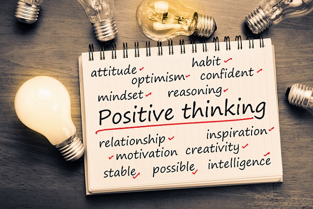 words on a notepad to describe positive thinking