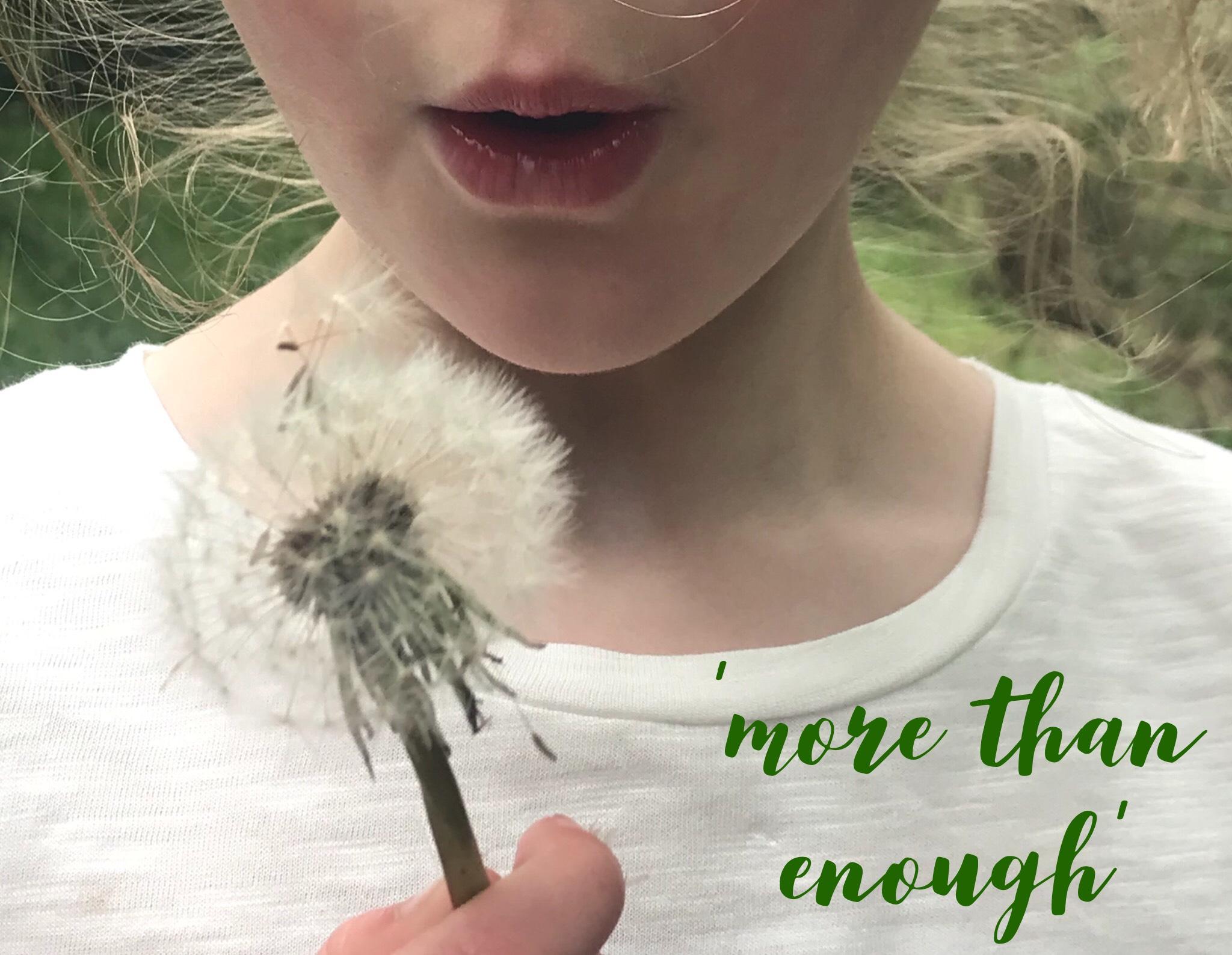 girl with dandelion symbolising gratitude