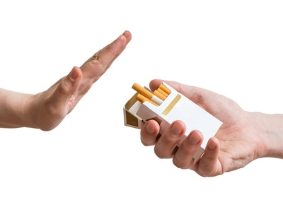 hand rejects offered cigarette