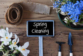 spring cleaning sign amongst flowers