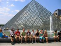 Enjoying the sunshine outside the Louvre.