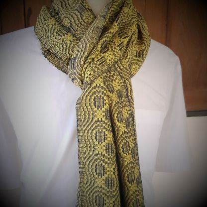 yellow scarf with twisted blue pattern