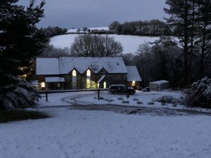 Stable Art, picture framing glowing in the snowy Cornish countryside