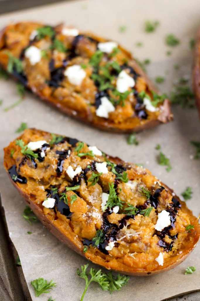 Goat cheese crumbles, sautéed balsamic onions and twice baked sweet potatoes make the perfect side dish or vegetarian dinner! #cleaneating #goatcheese #sidedish #sweetpotatoes #vegetarian