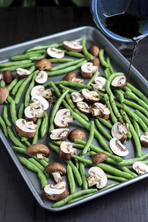 pour oil over green beans and mushrooms