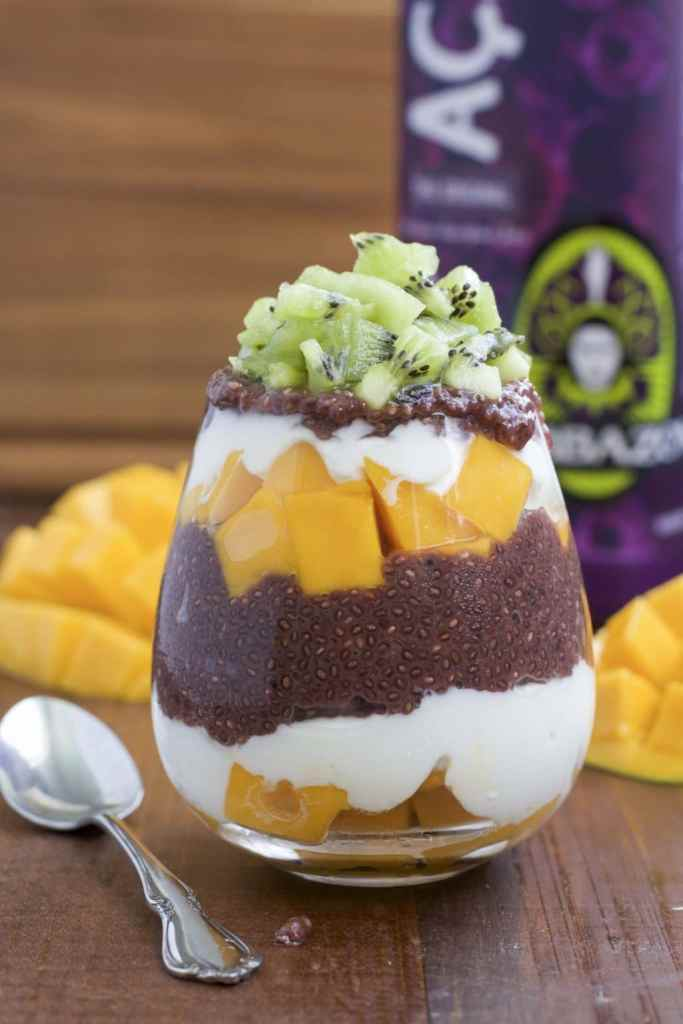 Protein-packed acai chia seed pudding made with acai juice layered with coconut yogurt, mango chunks, and topped with fresh kiwi! Perfect for a quick breakfast or healthy snack.
