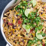 Creamy vegan taco pasta loaded with black beans, corn, onions, and fresh cilantro. You'd never know that the sauce is dairy-free, it's so thick and creamy from the cashews!
