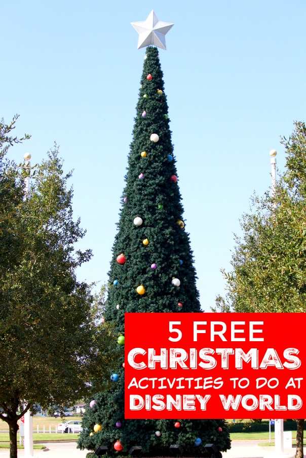 """The Contemporary Resort Christmas tree outside of its hotel with a sign that says, """"5 free Christmas activities to do at Disney World!"""""""