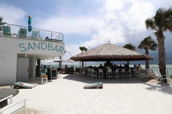 The Sandbar tiki hut and bar overlooking the water at the Opal Sands Resort.