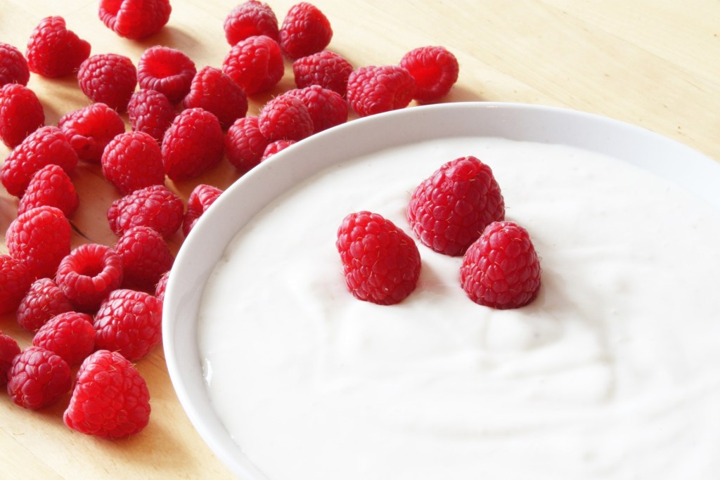 Yogurt in a bowl with raspberries